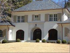 brick painted white (Benjamin Moore Ballet White –OC 9; the shutters are Benjamin Moore 977 Brandon beige