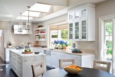 mod pendants, mixed countertop and backsplash surfaces, glass uppers + open shelves too