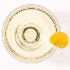 ... cocktail glass. Garnish with a lemon twist. --Cocktails in Bloom: 107
