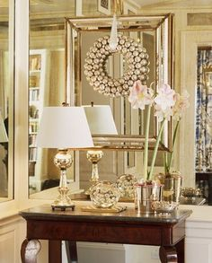 I like the layering of the look for a foyer - could combine the idea of hanging our initial over the mirror like the other post. Would use a combination of metallic and matte finishes to blend with my decor.