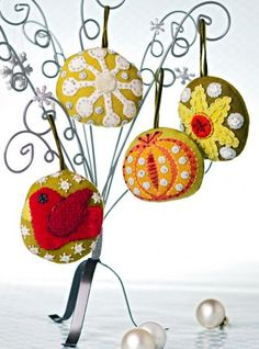 Increase your hand-embroidery know-how as you embellish holiday motifs on a set of stuffed wool ornaments.