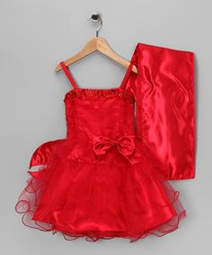 Satin fabric, a jewel-embellished neckline and stunning ruffled skirt make this luxurious dress a piece of poufy perfection. With an easy-on back zipper and a chic shawl for extra coverage, this fabulous frock pretties up any little princess. Includes dress and shawl100% polyesterMachine wash; tumble dry