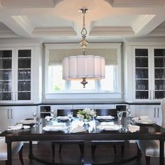 Dining room by Enviable Designs Inc.