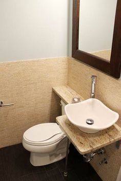 Help the eye flow by installing a custom shelf that fits under the sink and over the toilet. You'll barely even notice the exposed plumbing underneath. (But if you do, it matches the other fixtures.)