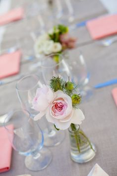 We think that any bride could arrange these lovely simple flower centerpieces!   Style me Pretty