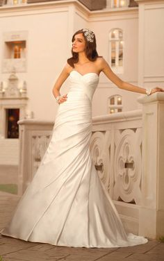 Simply Chic: Stella York Style 5852. Red carpet wedding dress feature glamorous rich Regal Satin and asymmetrical pleating. #SoStella #WeddingDress