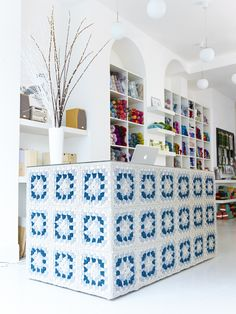 Crocheted yarn-bombed, granny-square shop counter