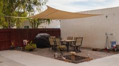 """""""This product has worked out perfectly for our new patio. It provides excellent shade, allows air flow, and looks  great. It has survived two """"monsoon"""" storms without any difficulties."""" - Customer from Mesa, AZ reviewing the ShelterLogic 16 ft. x 16 ft. Sand Square Heavy Weight Sun Shade Sail"""