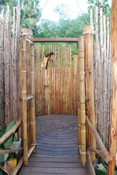 A rustic outdoor shower made from bamboo