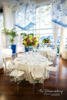 White linens and bright colored flowers brighten this wedding reception at Sequoia Restaurant. {Sequoia Restaurant}
