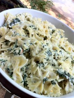 Spinach Artichoke Pasta. store: bowtie pasta/ reduced fat cream cheese/ milk/ reduced fat sour cream/ lemon/ can of artichoke hearts/ frozen spinach/