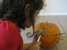Hammering Nails into a Pumpkin...great for scouts... hammer and nail practice!!
