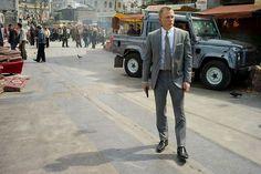 "Daniel Craig as James Bond in Istanbul in ""Skyfall"".  With gun."