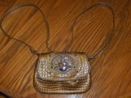 Price $12.97 Pretty Kathy Van Zeeland shiny gold croc purse. Smaller size that is perfect for the young gal or ladies that like to keep their handbags...