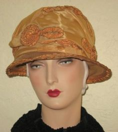 Gold 1920s cloche with ribbonwork trim