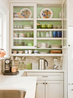 Cabinets! Love the glass with accent color.  http://www.hgtv.com/designers-portfolio/room/traditional/kitchens/9893/index.html#/id-9740/room-kitchens?soc=pinterest
