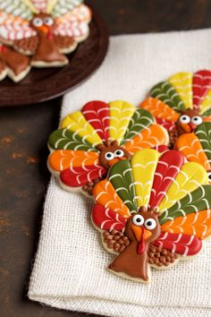 These decorated turkey cookies make great Thanksgiving favors. They are sugar cookies decorated with royal icing and are made from a tree cookie cutter.