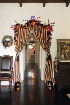 Decorating for Halloween with Style: Striped Deco Mesh makes for easy ( & reusable!) curtains for windows and entryways.
