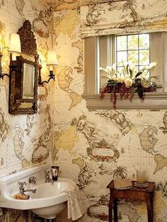 fabulous bathroom with vintage map wallpaper. pierre frey