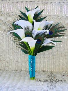 Peacock feather Indian wedding bouquet via IndianWeddingSite.com