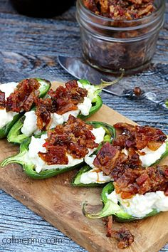 Grilled Stuffed Jalapeno Peppers with Brown Sugar Bacon - spicy jalapenos stuffed with creamy cheese and topped with sweet and smokey bacon.