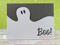 handmade Halloween card from Lil' Inker Designs ... clean and simple .... black and white ... borderline of ghost head divides a white section and a black with white polka dot section ... great card!