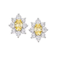 Monte Carlo Solei Earrings                                   Platinum on Silver Oval Stud Earrings with Canary Yellow and White Stones $150