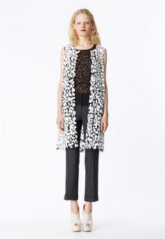 LOOK 18 Matte white mosaic sequin sleeveless coat.  Black honeycomb lace tank top.  Charcoal wool pinstripe trouser with black cotton poplin yoke .