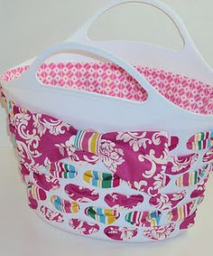 using $2 basket (plastic with holes and handles) from target plus fabric.