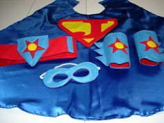 Children's Custom Superhero Personalized Kids Cape Including Matching Mask, Belt and Wrist Cuffs. $44.50, via Etsy.