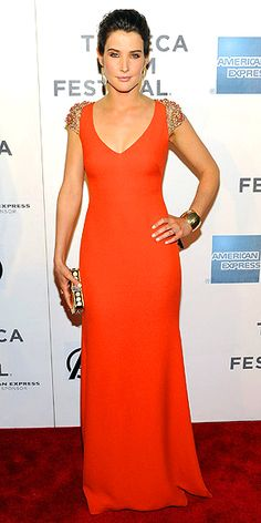 Cobie Smulders smolders in a bright Reem Acra gown with bejewled sleeves.