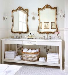 Swap out your basic bathroom mirrors with glam antique store finds...love this!