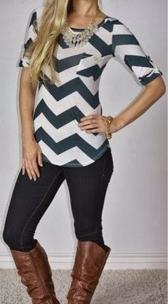 Black jeans, long boots, chevron style blouse and necklace