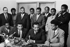Front row: Bill Russell, Muhammad Ali, Jim Brown, and Kareem Abdul-Jabbar (formerly Lew Alcindor). Back row: Mayor Carl Stokes, Walter Beach, Bobby Mitchell, Sid Williams, Curtis McClinton, Willie Davis, Jim Shorter and John Wooten.    This photo was taken in Cleveland, Ohio in 1967 and was a group of athletes that met to support Muhammad Ali's decision to not go fight in the Vietnam War after being drafted.