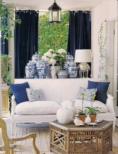 Updating an antique french settee in white helps create a lovely outdoor space, using blue and white. BJ Haus Design