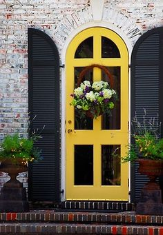 stylish patina, interior design, furnishings, home decor, virginia, DC, rough luxe , www.stylishpatina.com  What a lovely doorway! Arch, shutters, urns, brick. via thisivyhouse