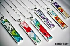 Beautiful resin pendants made with wallpaper or fabric