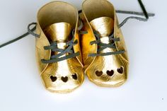 Gold baby booties with heart cutouts - Andrea's Notebook
