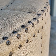 Burlap Upholstered Ottoman with tacks