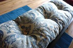 DIY bench cushion -- find some old curtains or fabric @ a thrift store? Can also make matching for bench seat & dining room chairs