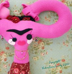 She's a Frieda Kahlo Uterus doll. I know, right? What would our mothers say?