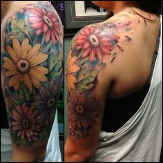 This is my 5th, largest and most favorite tattoo. It was done by the wonderfully talented Coty Vondracek in San Bernadino, Ca. It took 2 sessions for a total of 11 1/2 hours. check him out on instagram @John Searles Searles Vidrine. Gerbera Daisies have always been my most favorite flower, and I wanted a girly beautiful tattoo to be my halfsleeve.