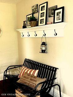 White shelf with black hooks