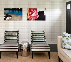 Create the illusion of an entry way with patterned wallpaper along one wall, and by confining furniture to an area rug.