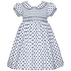 Short sleeve Navy Polka Dot summer dress for babies and young girls.