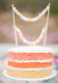 All kinds of sweet treats were used for #engagement shoot Props - including this ombre-style #nakedcake. Photography: Peter + Veronika. See more on SMP: http://www.StyleMePretty.com/destination-weddings/2014/02/06/colorful-engagement-session/
