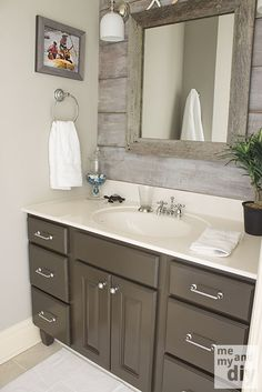 weathered tones mixed with gloss grey bathroom cabinet- LOVE the wood behind the mirror