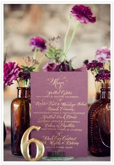 Purple centerpieces with gold accents. Love the gold. Maybe a fall wedding with the right purple?