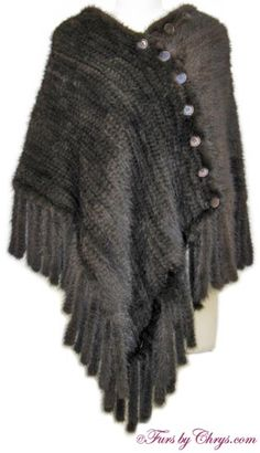 SOLD! Knitted Ranch Mink Cape RM738;Like New Condition; One Size Fits Most. This is an amazing genuine knitted ranch mink fur cape. It has Levinsky label and features fringe trim around the entire cape hem. It has buttons all around both front and back, so it is a very versatile piece. If all of the front buttons are undone, it may be worn as a shawl. It is constructed of knitted mink so it is very lightweight and there is no lining. It is perfect for spring or fall, or for milder climates.