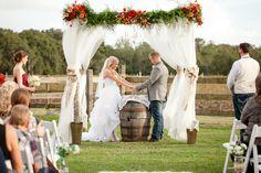 Real Weddings: Ashlei & Steven in Plant City, FL | Sunflowers, barn wedding, vintage barn doors, burlap runner, arbor